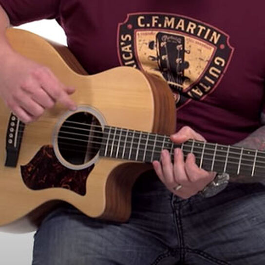 How to Hold a Guitar When Seated
