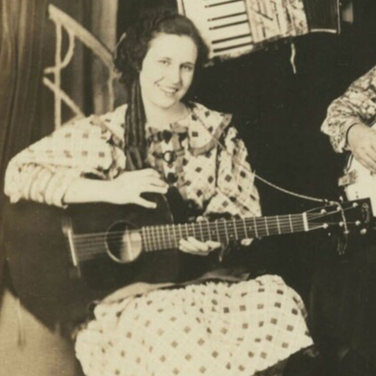 Black and white vintage girl playing guitar