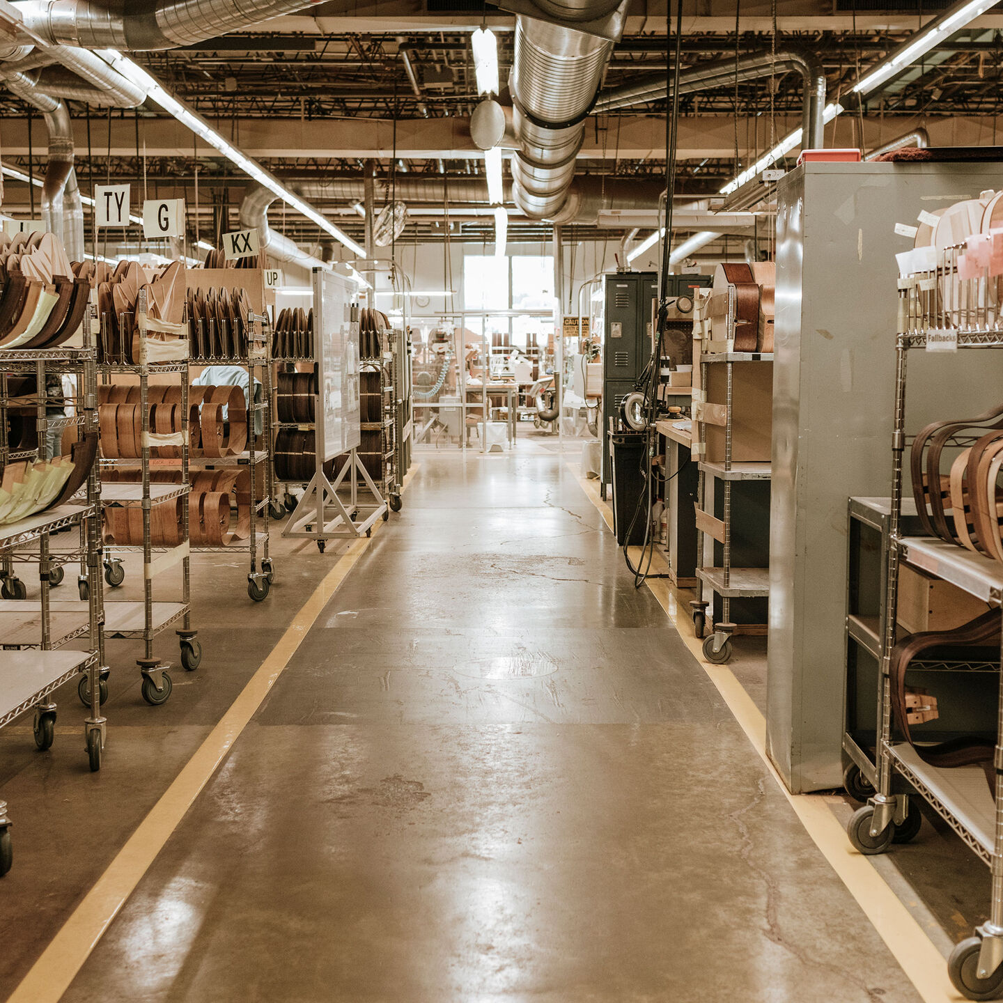 Factory with partially guilt guitars